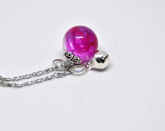Guardian angel necklace, including resin ball, fuchsia angel, true feather, bell