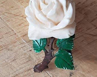 1950s white rose brooch with delicate stem and leaf detail