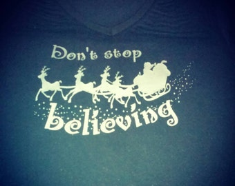 Don't stop believing Santa clause shirt.