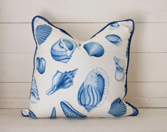 Seashells in rich blue throw pillow with blue cording