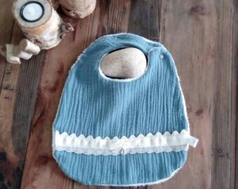 Baby bib in blue cotton gauze