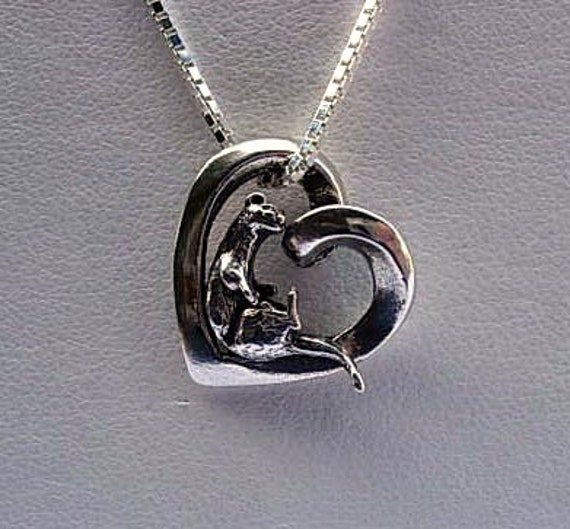 Otter love otter heart pendant te gusta este artculo aloadofball Image collections