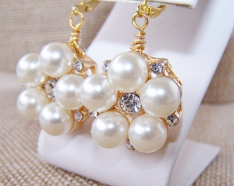 Chunky faux gold pearl and rhinestone earrings