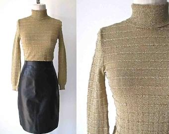 Italien des années 1970 en tricot col roulé métallique or - XS/S