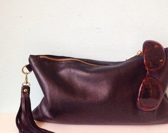Oversized black leather clutch bag, zipped purse, make up bag