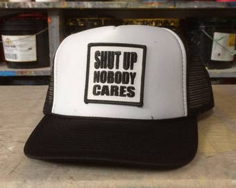 Shut Up Nobody Cares Trucker Cap by Seven 13 Productions embroidered patch anti-politics skate punk patch on Mesh back Otto cap hat