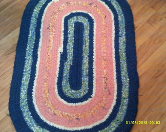 Blues and pinks toothbrush handle rug.