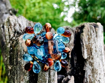 Large blue and brown glass drops ring