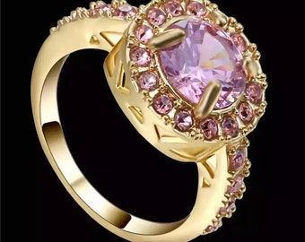 10kt gold filled ring with cz pink sapphires. The ring is a size 8