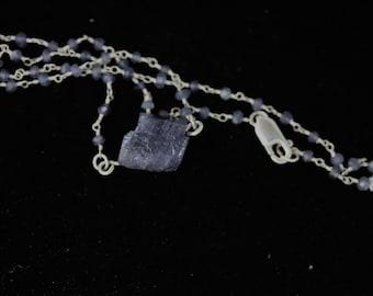 Tanzanite pendant, on Iolite beaded silver chain lobster clasp