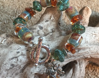 SAND AND SEA, artisan lampwork and sterling silver bracelet.