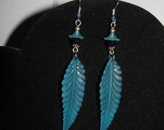 Feather earrings in sky blue lucite