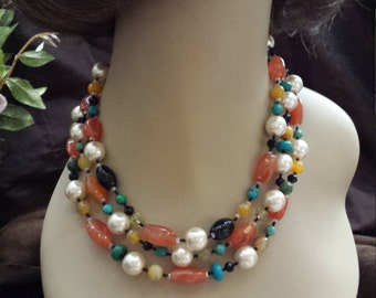 Three strand necklace made with carnelian, turquoise, and pearl