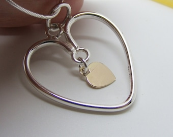 Sterling Silver and Gold Moving heart pendant, heart jewelry, Fluid by design