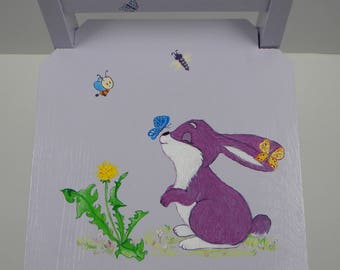 baby wooden chair painted handmade decor rabbit and Butterfly purple background
