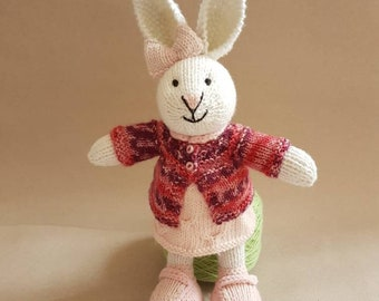 White girl Bunny with pale pink shoes and dress with variegated rose and pink cardigan