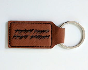 One Keyring to Rule Them All: The One Ring inscription laser engraved leatherette keychain. customise with your name in English or Elvish!
