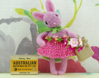 Handmade pink pom pom bunny rabbit with shopping bag. Hanging ornament.