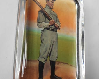 A retro style Paperweight with lithograph of Turn of Century Baseball Player.