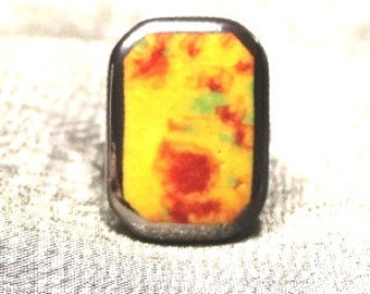 Pretty yellow ring of ceramics with red and green spots.