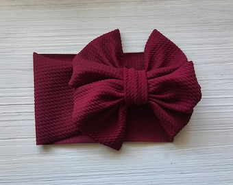 Stretch burgundy baby headwrap bow ( melody bow)