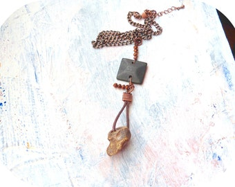 Necklace of handmade clay bead with chocolate wood square and bronze crystals