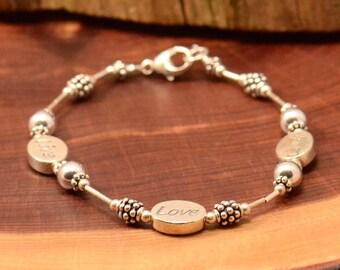 sterling silver inspiration live love laugh charm bracelet