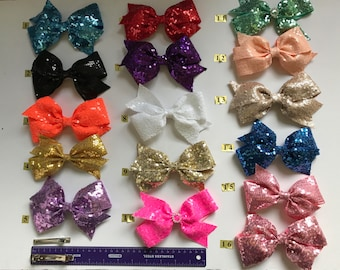 Hair bow clips for girl  made by sequin fabric in many models each 8.00