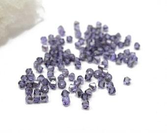 Swarovksi Crystal Bicone Tanzanite Satin Bicones 4mm 12 pcs