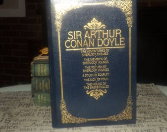 Vintage (1986) hardcover book Celebrated Cases of Sherlock Holmes. Sir Arthur Conan Doyle. Octopus Books. Printed USA. Faux leather cover.