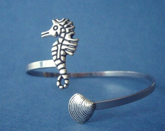 silver shell cuff bracelet wrap style with a sea horse