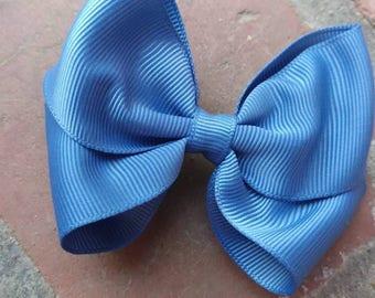 Blue hair bow. Medium blue hair bow. Blue bow. Medium size toddler gair bow. Bow. Blue toddler bow. Medium blue bow