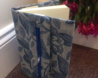 Fabric covered notebook with pencil case attached