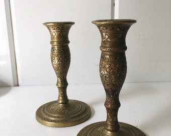 Pair of two painted brass candle stick holders