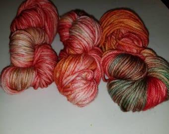 "Terri, a hand-dyed superwash merino wool bulky weight yarn. 137yds/100gms/hank.  3-3.75sts=1"" on #10-11 needles."