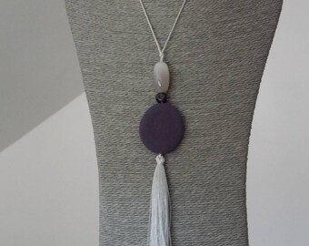 Great silver necklace and plum, dark, with silky tassel and large gray agate bead.