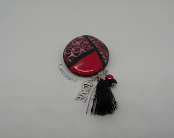 Round brooch black and red