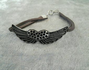 Winged heart bracelet with gray suede