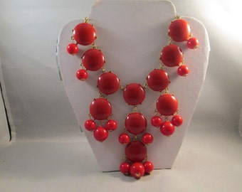 Bib Necklace with Red Bubble Beads on a Gold Tone Chain