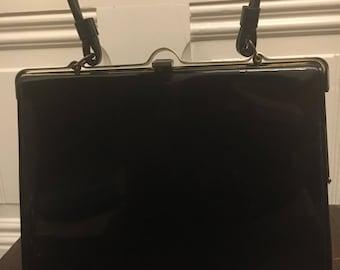 Black vintage patent leather handbag