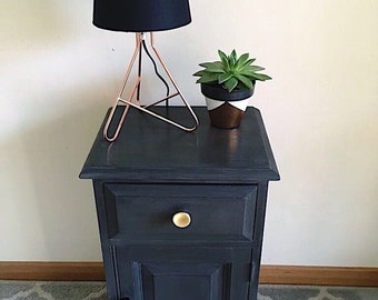 Painted black wooden bedside unit/ gold handles/ floral lining