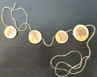 Fall wood circle banner in Orange font.  Circles are 1 to 2 inches.
