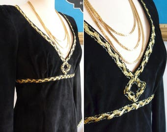 Low-cut neckline leather / suede dress with gold trimming