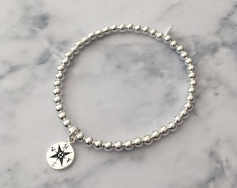 Sterling Silver stretch bracelet with Compass charm