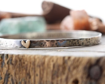 hand stamped personalized sterling silver bangle bracelet with golden heart