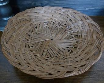 Woven dish, plate, basket, tray.