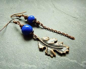 Asymmetrical earrings copper leaf and blue beads
