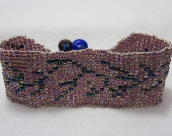 Beaded Cuff Bracelet Navy Blue Design on Pearlized Beads Background