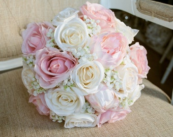 Romantic ivory and blush pink silk wedding bouquet. Made with artificial roses, peonies and gypsophila (baby's breath).