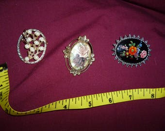 Three Sara Coventry pins A312